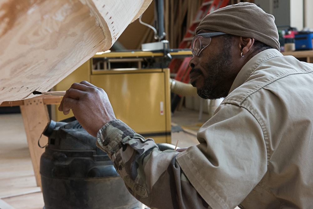 Marine Tech student working on a boat at Seattle Central's Wood Technology Center